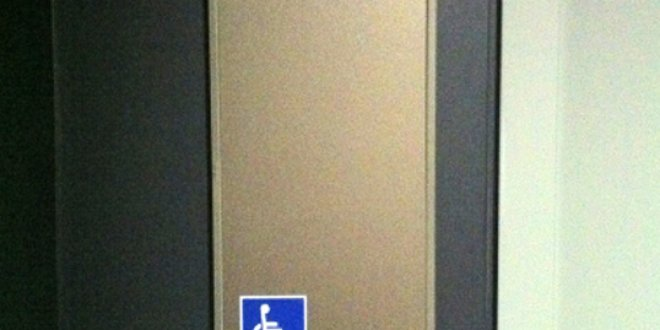 Toilet signage with Braille